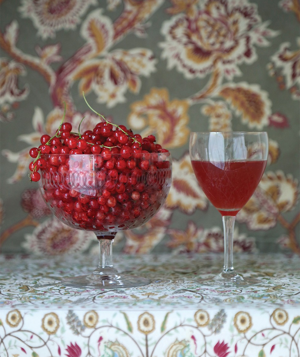 Fresh-picked red currants sit aside black currant mead from the previous year. - PHOTO: PETER BARRETT
