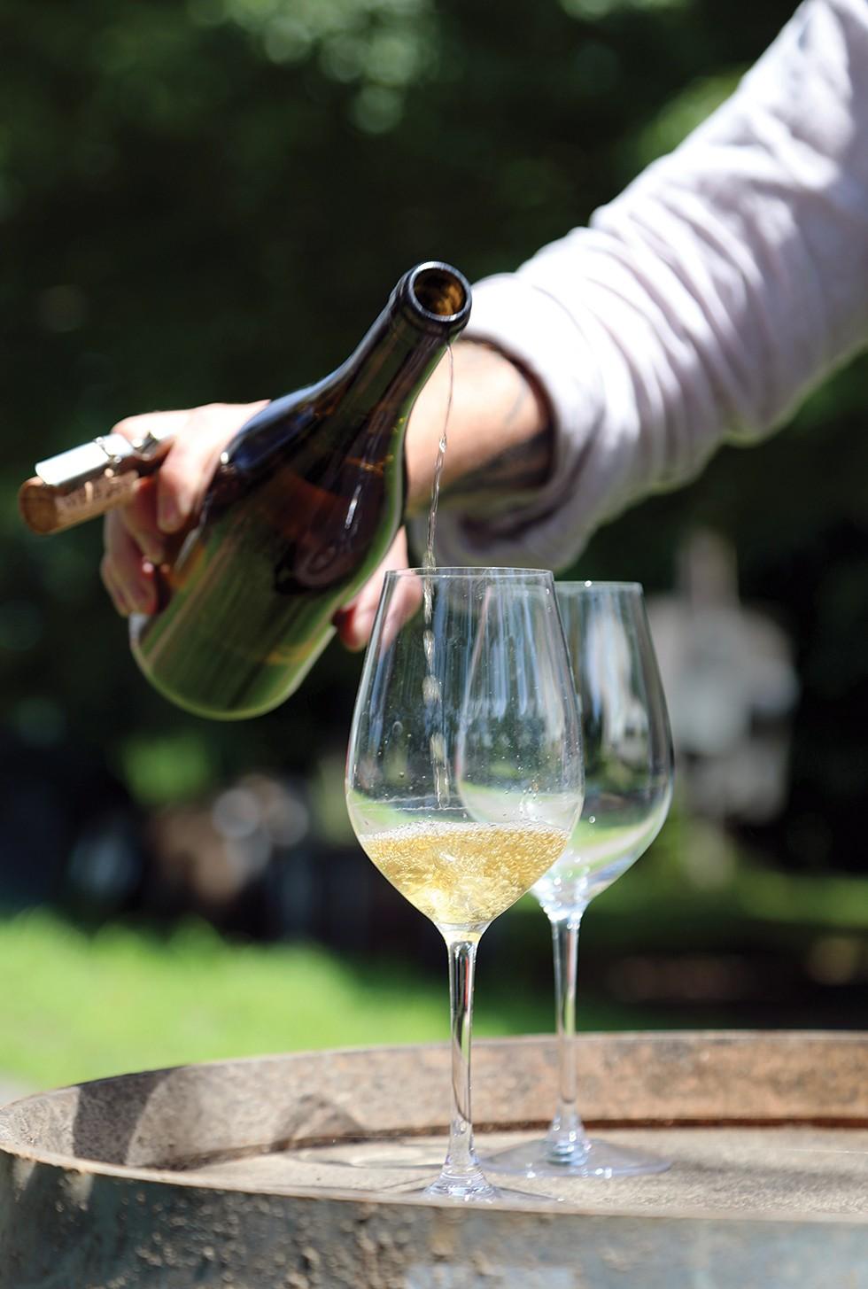 Pouring the 2018 Chardonnay. - PHOTO: PETER BARRETT