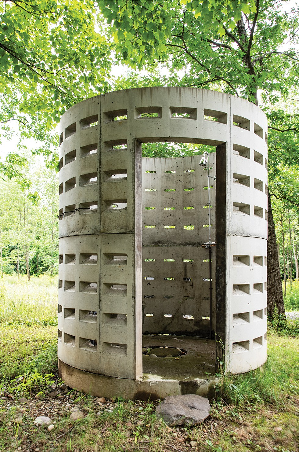 """To create an innovative outdoor shower, the couple bought two septic dry wells from local concrete supplier Keeler Vault, stacked them and installed plumbing. """"At first they said, 'You want to do what with the septic wells?' But now everyone gets it,"""" says Betts. - PHOTO: DEBORAH DEGRAFFENREID"""