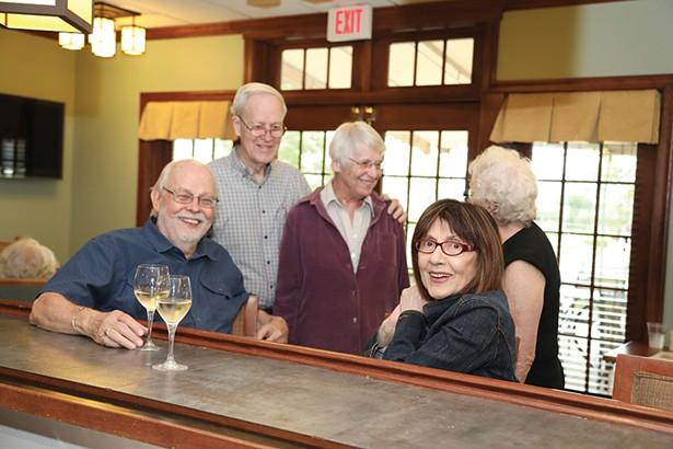friends catch up at Woodland Pond's pub.