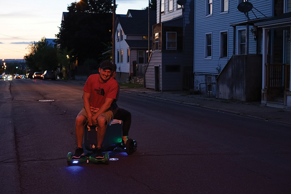 Justin and Brittany Quinones take a night ride on their mobile cooler. - PHOTO: JOHN GARAY