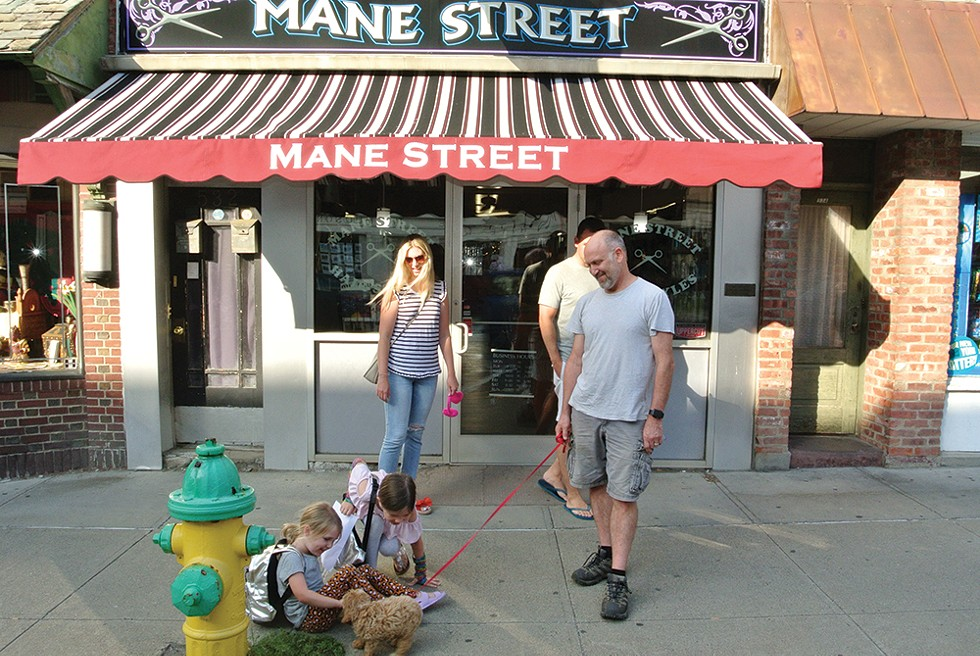 Johnny, Caitlyn, Hazel, Violet, Oliver, and Peanut in front of Mane Street on Warren Street in Hudson. - PHOTO: JOHN GARAY