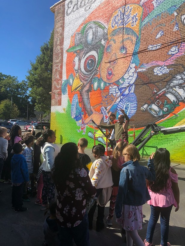 Artist Risa Tochigi discussing her mural with Kingston students. - PHOTOS COURTESY OF O+ FESTIVAL