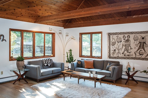 """A corner of the home's living room is devoted almost exclusively to Midcentury Modern design pieces. """"We love that MCM is functional and practical, yet has a fun, playful side that inspires us to live better,"""" says Moser. """"After World War II there was such hope for the future—new manufacturing techniques and materials like plywood, plexiglass, and plastic had been invented. Ambitious designers were eager to implement them into affordable furniture for the growing middle class."""" - PHOTO: DEBORAH DEGRAFFENREID"""