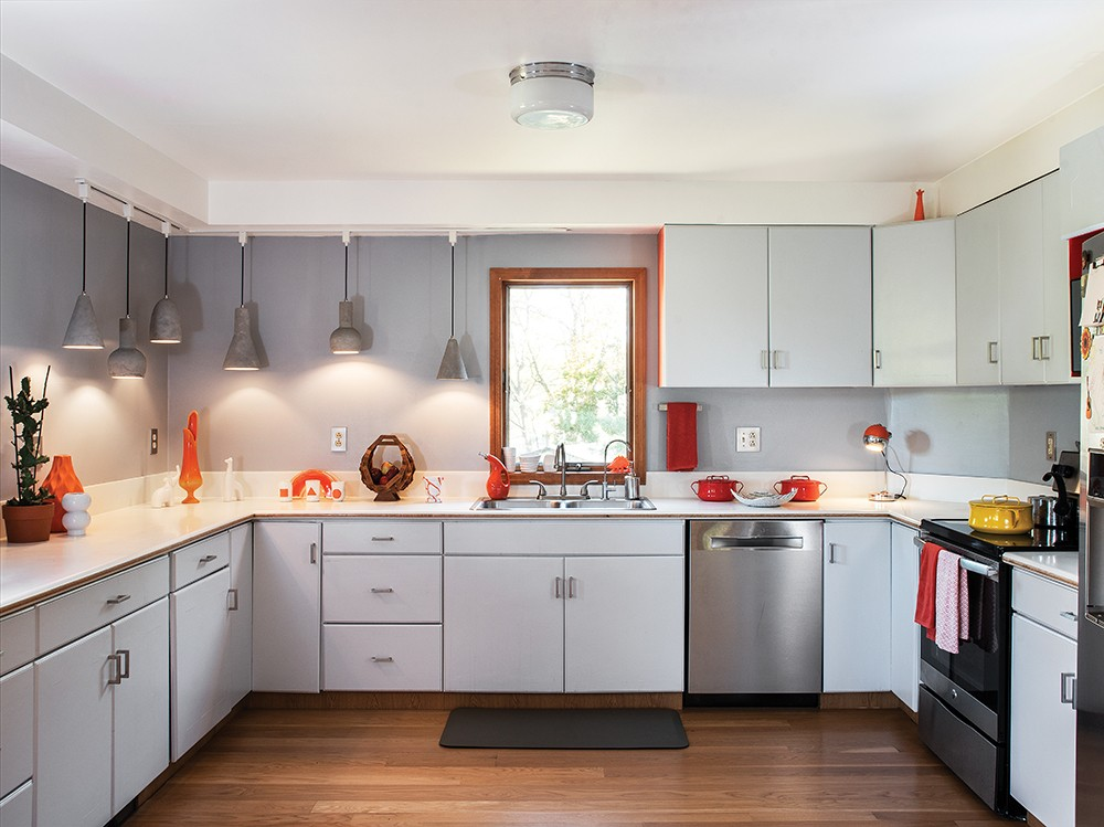 """The kitchen of Jordan Moser and Hilary Davis gutted and redesigned the home's open kitchen then filled it with an eclectic assortment of refurbished finds. """"It makes us so happy to bring old, forgotten objects back to life,"""" says Davis. - PHOTO: DEBORAH DEGRAFFENREID"""