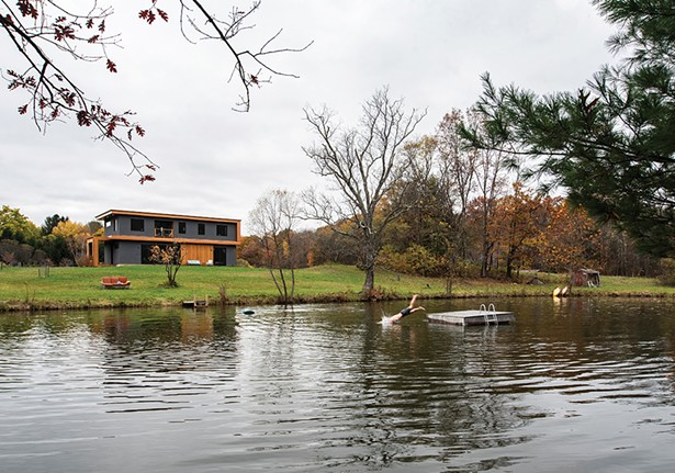 The large pond was the first thing Eric Schmidt noticed about the open seven acres of land that was to become the site of the modernist-inspired home. Built by the previous owner for - his wife, the pond was stocked with koi so the couple could feed them together as they sat by the water's edge. - PHOTO: DEBORAH DEGRAFFENREID