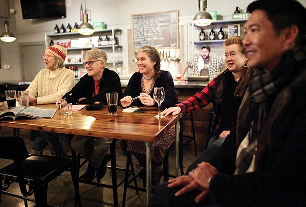 Catskill Merchant Coalition members meet at - Crossroads Brewery and Taproom on Water Street. (Left to right: Chrisie Cordrey of Corduroy Shop, Rodney Greenblat of The Rodney Shop, Kristi Gibson of Magpie Bookshop, Jill Lamanec of the Frisbee Agency, Michael Moy of Joe's Garage, and Rob Sager of Crossroads behind the bar.) - PHOTO: NIVA DORELL