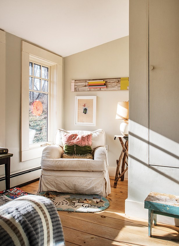 """After restoring her studio, Feinberg finally turned her attention to the garage apartment she'd been living in. She fully winterized a wrap-around covered porch to exponentially expand the apartment's living space. In one corner, what was once used for storage is now a sunny sitting nook, decorated with her art as well as second-hand finds. """"My work falls somewhere between painting and object,"""" she says. - PHOTO: DEBORAH DEGRAFFENREID"""