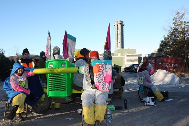 In November 2019, local residents locked down to a tractor for eight hours to protest construction operations at Cricket Valley fracked gas plant. - PHOTO: JESS MULLEN/ NEW PALTZ CLIMATE ACTION COALITION