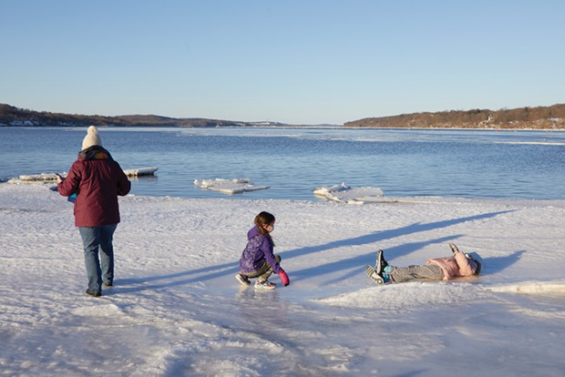 Frolicking on Hudson River ice in early February near the Saugerties Lighthouse.