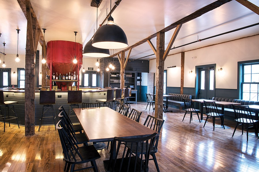 The centerpiece of the bar is a grain hopper, formerly used in the building's incarnation as a feed store.