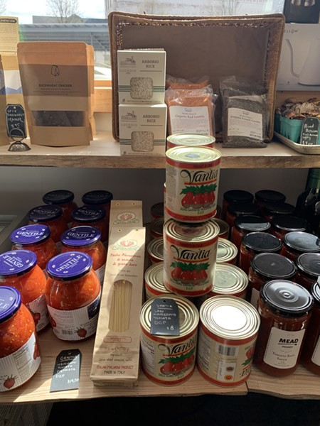 They are also selling packaged and canned items. - VILLAGE COFFEE AND GOODS