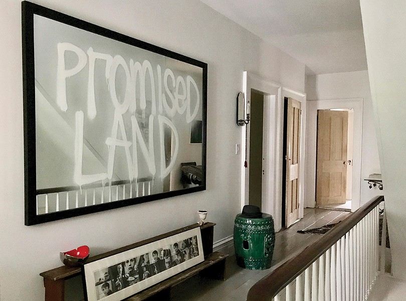 The couple's extensive contemporary art collection includes a number of pieces by Rashid Johnson, whose Promised Land dominates the second-floor hallway landing.