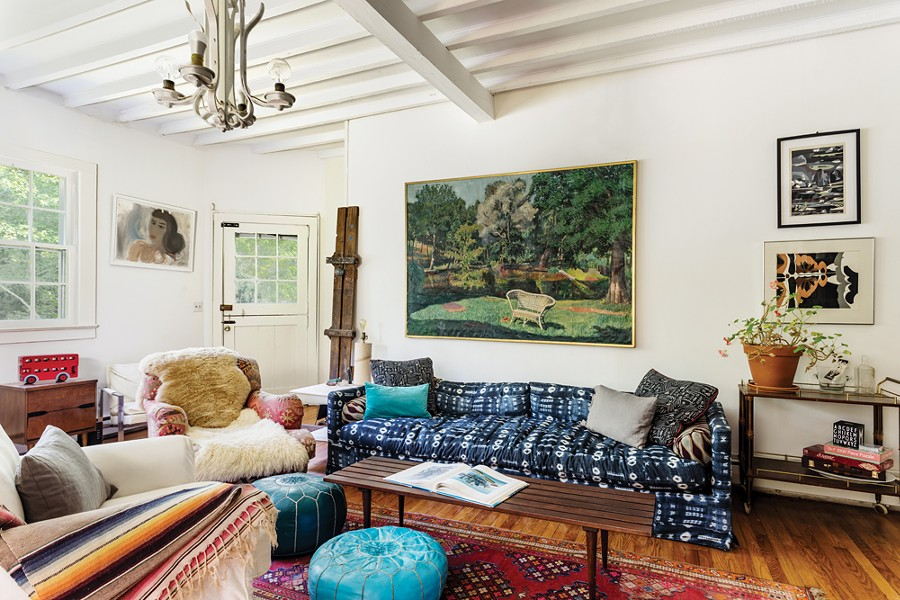 The living room features a painting by Letizia Pitigliani over the couch, prints by Robert Angeloch over the bar cart (a family heirloom), and Simi Stone's Aubergine is on - the far wall. - PHOTO: WINONA BARTON-BALLENTINE