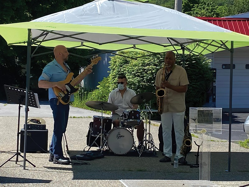 From left: Brian Kastan, Mike Pride, and Eric Person perform a free concert outside Kastan Art Space in Warwick on June 13 - PHOTO: MARIA KASTAN