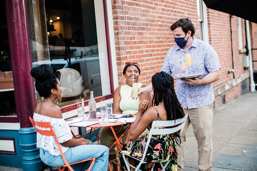 Michael Kelly serving diners outside at Liberty Street Bistro in Newburgh. - MARY KELLY