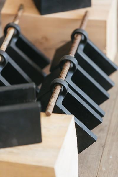 Blackline doorstoppers handmade from cast iron.