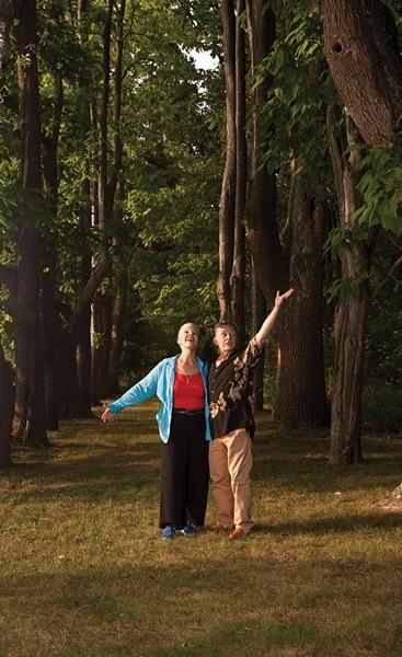 "Irene O'Garden and John Pielmeier amongst the trees of ""Windway."" - DEBORAH DEGRAFFENREID"