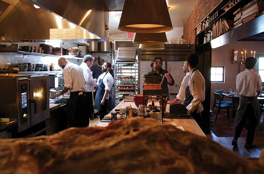 Pelaccio and crew in the Fish & Game kitchen. - PETER BARRETT