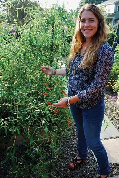 Liz Elkin demonstrates how easy it is to propagate curly willow. - LARRY DECKER