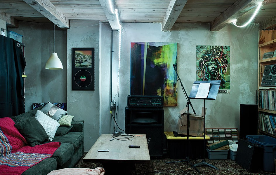 "The home's original basement now serves as a sort of mancave for Marko. Heated by radiant floor heating, the space is decorated with some of his work and memorabilia and also serves as the ""final resting place"" for his extensive record selection. - DEBORAH DEGRAFFENREID"