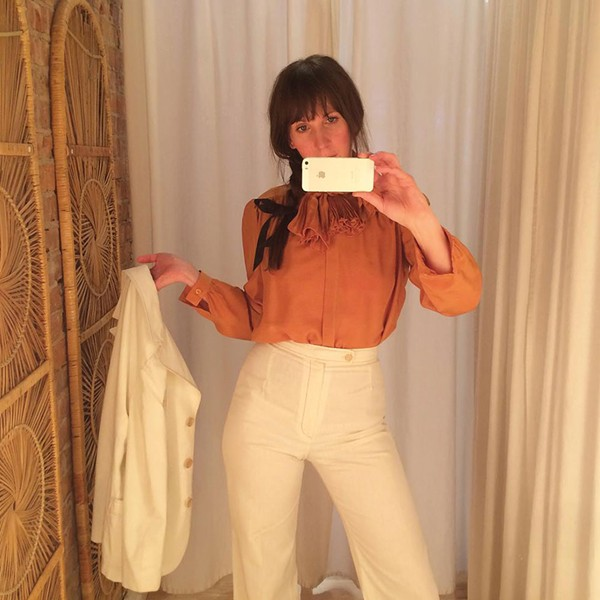 Darbie wears a 1980s Valentino silk blouse and 1970s white cotton pantsuit all from Lovefield Vintage in Kingston.