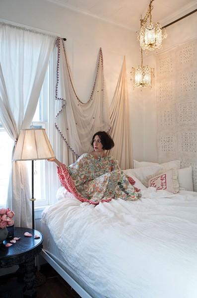 """Khorramian in her downstairs bedroom wearing another of her silk """"kaftoons."""" - DEBORAH DEGRAFFENREID"""