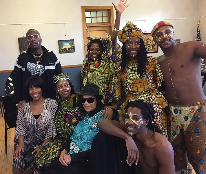 The Badilla family—Milandou, Nkoula, Ntangou, Ntchota, Ngounga, Mounnanou, and Pamela— with Gloria Stewart and Debbie Waithe at the Hudson Area Library.