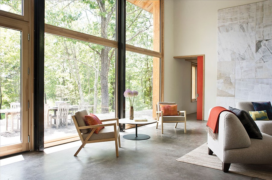 An abundance of south-facing, triple-glazed windows in the double-height living room fills the home with light and capture heat in the winter.They also offer a view of the Shawangunks—bringing the outdoors inside throughout the year. - DEBORAH DEGRAFFENREID