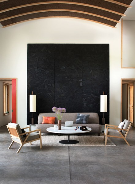 In the living room, Reynolds displays fabric wall art pieces by DesignWork, a zerowaste art project crafted from recycled Eileen Fisher clothing.Eileen Fisher served as a consultant on the project.The home's arched cork acoustical ceiling was installed by local craftsman Lee Sahler. - DEBORAH DEGRAFFENREID
