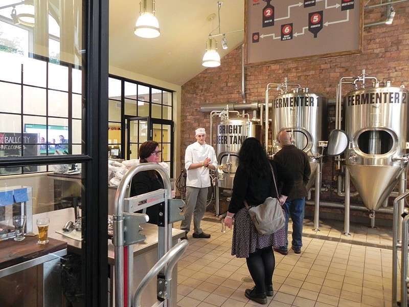 Brew U attendees tour the CIA's on-campus brewery.