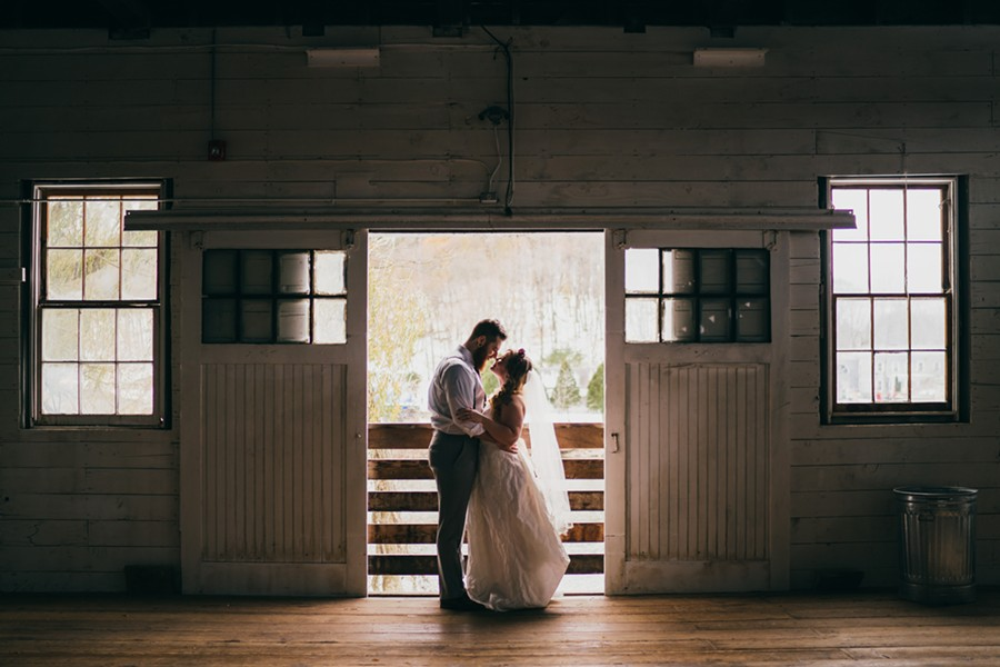 The couple steals a moment in the Creekside Studio. - JOSHUA BROWN PHOTOGRAPHY, COURTESY OF LUMBERYARD