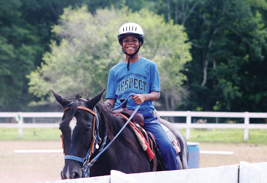 Horseback riding at the Frost Valley YMCA camp.