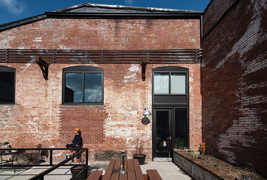 Robin Rice's loft is one of 200 renovated spaces in The Lofts at Beacon created from a 19th-century textile mill. Right next to the Fishkill Creek's dam and waterfall, the live/work spaces incorporate many of the original industrial features and enjoy multiple community spaces both indoor and out. - PHOTO: DEBORAH DEGRAFFENREID
