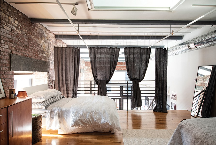 The upstairs sleeping loft features a dresser from the Italian design house Calligaris as well as Pilkington's handmade textiles. Rice's framer made her mirrors for the space and architect Aryeh Siegal helped her hang privacy curtains. - PHOTO: DEBORAH DEGRAFFENREID