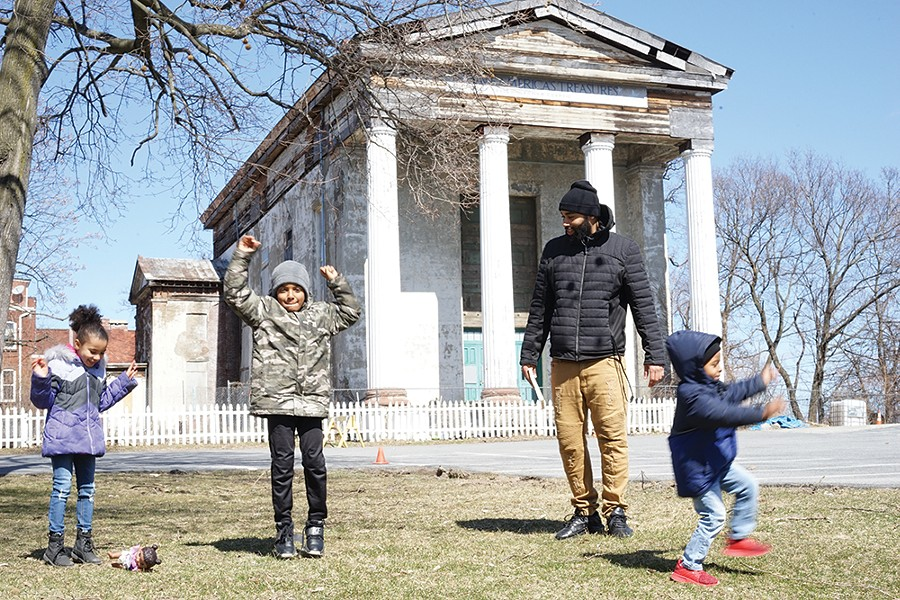 Carmela, Zach Jr., Giovanni, and Zachary Murry in front of the Dutch Reformed Church on Grand Street. - PHOTO: JOHN GARAY