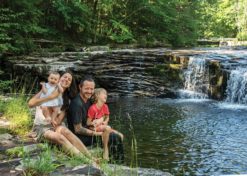 Duncan, Masse, and their two children, Ida and August, by the stream that forms the northern border of their property. - PHOTO: DEBORAH DEGRAFFENREID