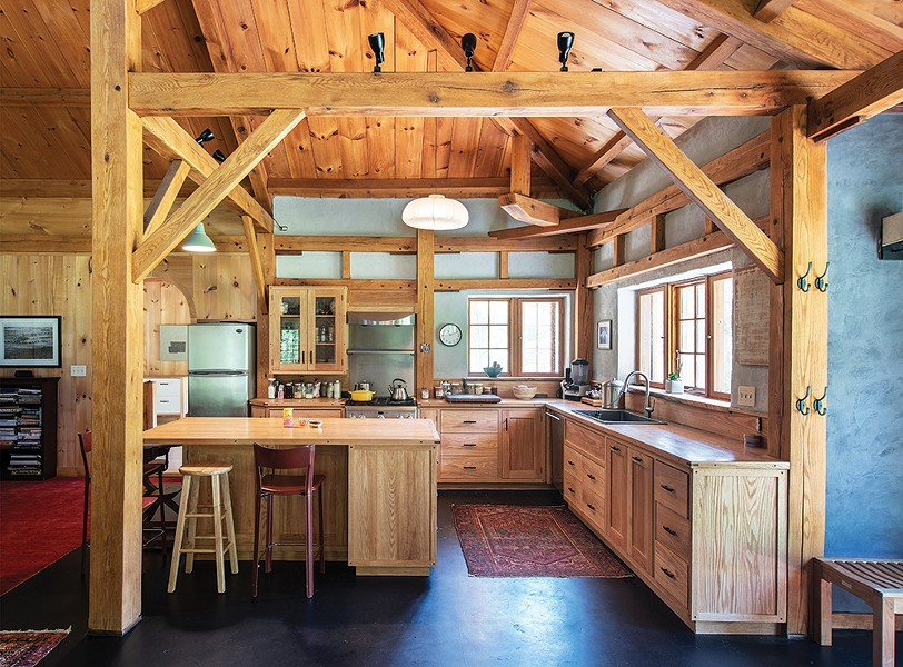 Jeff Gagnon of Rondout Valley Natural Builders helped Duncan design and build the home's main kitchen. RVNB also helped with the home's wall finishes, the clay floor, and the bathroom tile. In addition to the main living area and adjacent temple space, the home has a smaller guest kitchen, four bedrooms, and two baths. - PHOTO: DEBORAH DEGRAFFENREID