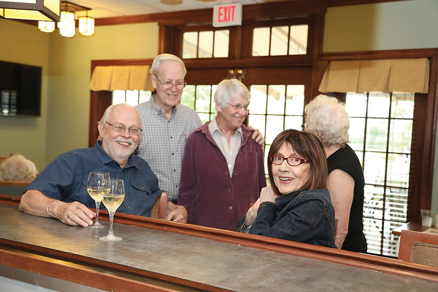 friends catch up at Woodland Pond's pub.