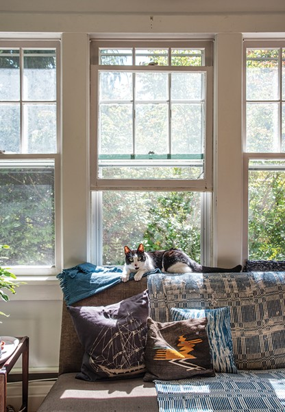 """The home's living room looks out to the natural bounty of the Hudson Valley. """"With each season, we've loved learning about the particulars of nature in a new ways,"""" says Lafferty. - PHOTO: DEBORAH DEGRAFFENREID"""