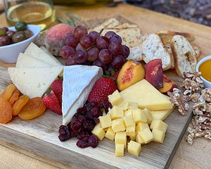 Local charcuterie and cheeses sourced by Main Course Catering highlight the Party and Gift Box alongside your choice of wine from Millbrook Vineyards, whiskey from Tuthilltown Spirits, or beer from Mill House Brewing Company.