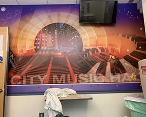 Inside the ER at Westchester Medical Center there's a special treatment room with a mural of Radio City Music Hall—which was strangely comforting. But where were the Rockettes? This photo was taken by the author from his bed on July 9 at 11:30pm.