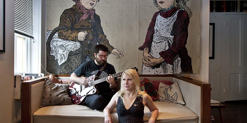 Home Is Where the Art Is Eddie and Janet in their living room with art by Derek Erdman Deborah DeGraffenreid