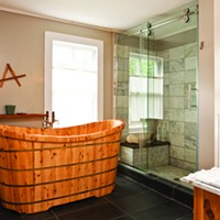 The Country Farmhouse Gets Creative Repurposing in Bloomington O'Connor and Osburn did a complete bathroom renovation in 2013, including the addition of a three-foot-deep cedar tub. Deborah DeGraffenreid