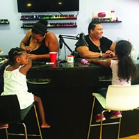 Stoking the Fire—Kingston Karimah Colden (left) and Jovana Incardona (right) doing nails at Love Hair Salon. Photo by Keith Carollo