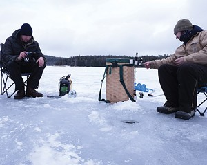 Kingston natives Brandon (left; he declined to give his last name) and Anthony Jansen fishing on North Lake, where the ice was seven inches thick. They'd been out since 4:30 in the morning, drilling holes and dropping lines as they moved down the shoreline. The two started fishing together five years ago, after Anthony began dating Brandon's sister.