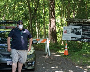 A Marbletown municipal employee guards the entrance to a path running along High Falls on July 5. Marbletown began posting a guard here after 18-yearold Chris Bamba drowned at High Falls on June 23.