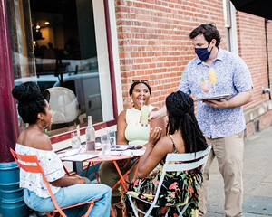 Michael Kelly serving diners outside at Liberty Street Bistro in Newburgh.