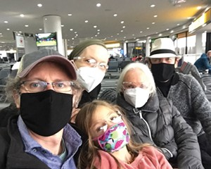 Jennifer May and family in the Newark Airport terminal, on their move to Canada.