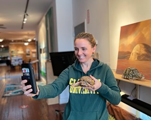 Brigette Walsh, MAT '19, Assistant Director of Environmental Programs at Clarkson's Beacon Institute, is introduces Edward, an Eastern Box Turtle, to 20 fifth graders from Beacon's Sargent Elementary School.